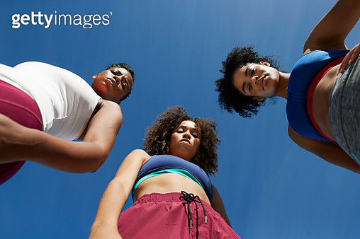Directly below portrait of female athletes standing on sunny day - gettyimageskorea