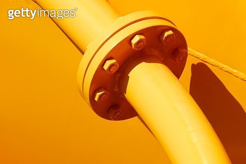 Yellow pipes joined by bolts at a flange, Emmendingen, Baden-Wuerttemberg, Germany - gettyimageskorea