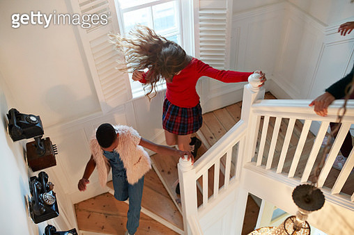 Top view of girls running down staircase, at home - gettyimageskorea
