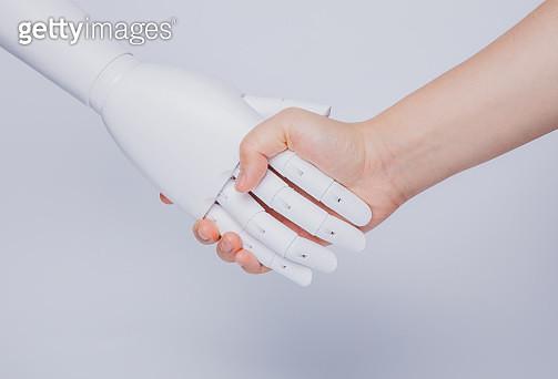 human hand shaking robotic hand - gettyimageskorea