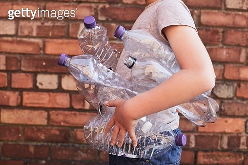 Child recycling plastic bottles - gettyimageskorea