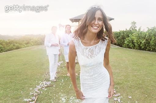 Young bride during wedding reception in gardens - gettyimageskorea