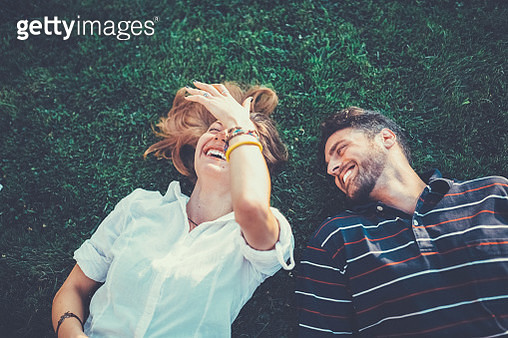 Happy couple in the grass dreaming - gettyimageskorea