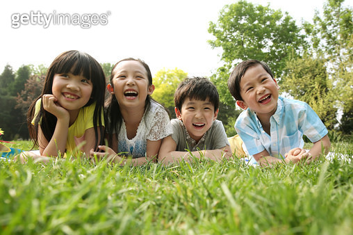 Children playing on the grass - gettyimageskorea