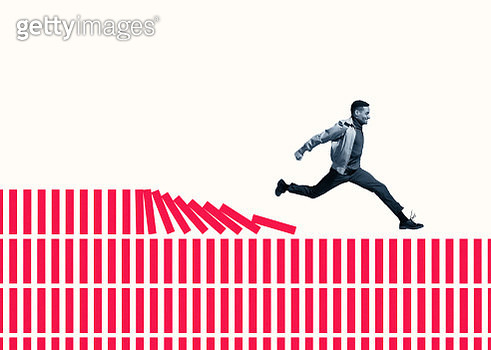 Happy young man running on red columns - gettyimageskorea