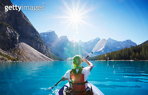 Mid adult woman kayaking, Moraine Lake, Alberta, Canada - gettyimageskorea