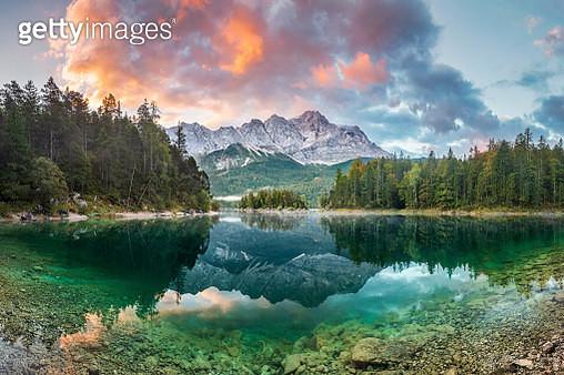 Mountain peak Zugspitze Summer day at lake Eibsee near Garmisch Partenkirchen. Bavaria, Germany - gettyimageskorea