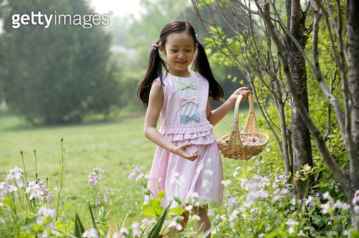 Cute little girl playing outdoors - gettyimageskorea