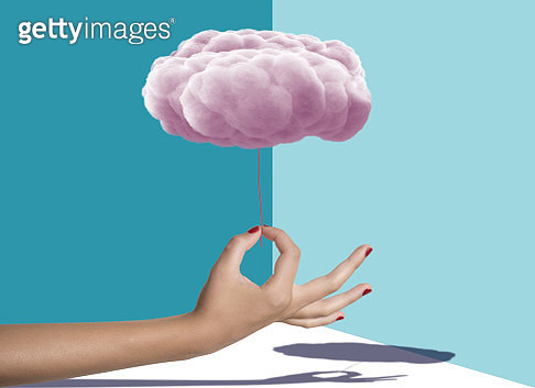 Cropped Hand Holding pink cloud Against colored background.Digital composite - gettyimageskorea