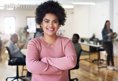 Portrait of a confident young businesswoman working in a modern office - gettyimageskorea