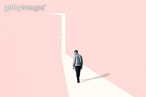 Sad young man walking towards ajar door - gettyimageskorea