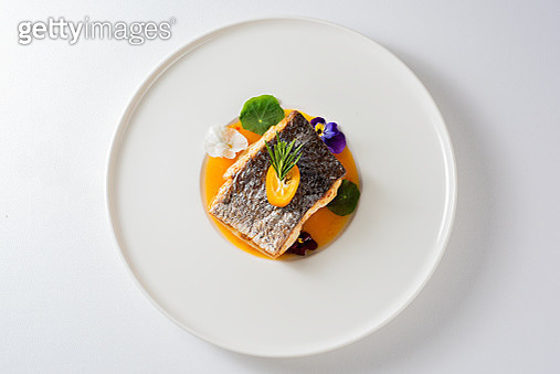 Grilled sea bass with citrus sauce - gettyimageskorea