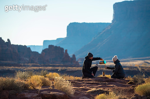 A man and woman camping in the desert - gettyimageskorea