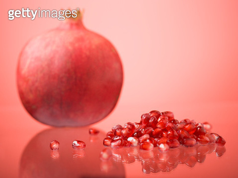 Pomegranate and pomegranate seeds. - gettyimageskorea