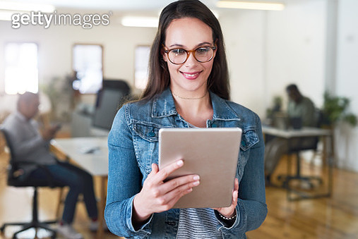 Shot of a young businesswoman using a digital tablet in a modern office - gettyimageskorea