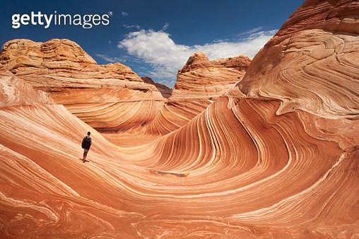 Lone hiker at Arizona's Wave - gettyimageskorea