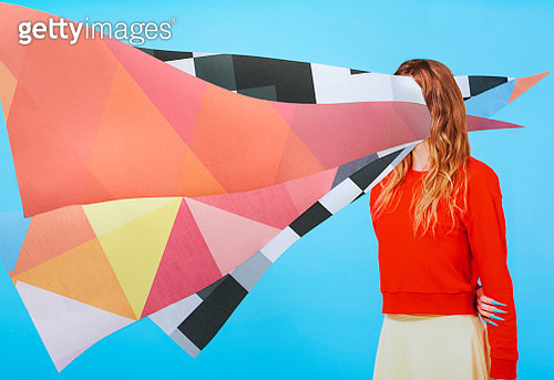 collage of woman with paper on head - gettyimageskorea