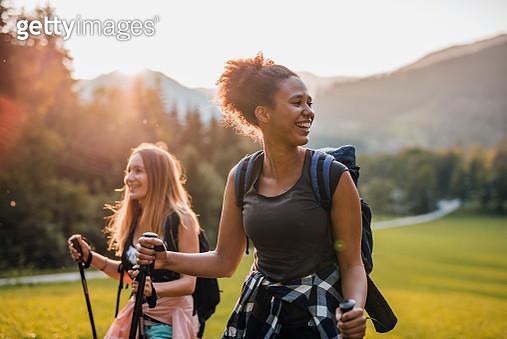 Candid Portrait of Female Friends Hiking in Jezersko Valley - gettyimageskorea