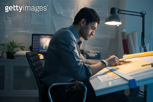 Architect working at drafting table in office - gettyimageskorea