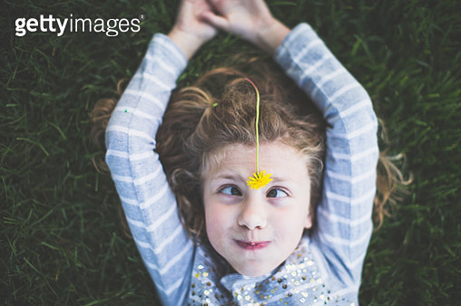 Girl with Dandelion on Her Head - gettyimageskorea