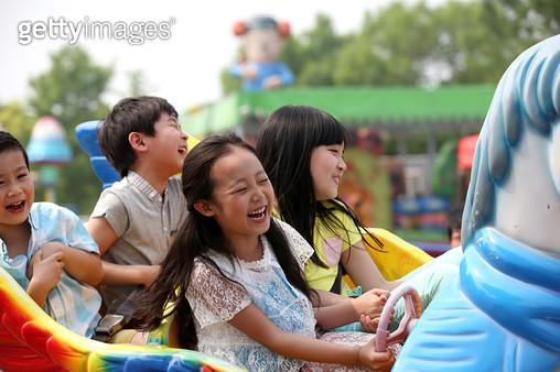 Happy children play in the playground. - gettyimageskorea