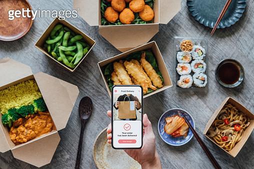 Ordering Takeaway Meal At Home - gettyimageskorea