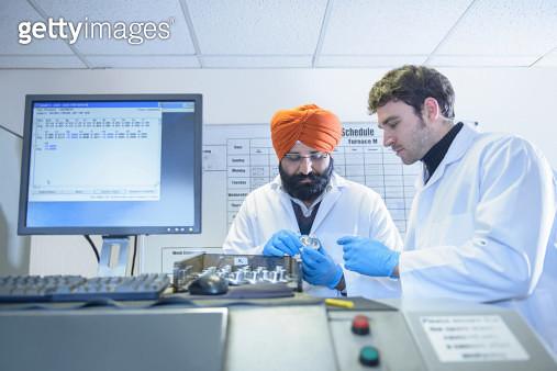 Scientists testing aluminium samples in aluminium foundry - gettyimageskorea