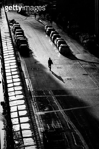 High Angle View Of Silhouette Man Walking On Street At Night - gettyimageskorea