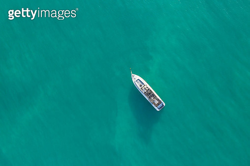 Aerial top shot of a luxurious yacht on the sea - gettyimageskorea