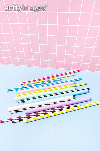 Many Paper Drinking Straws On Blue Background - gettyimageskorea