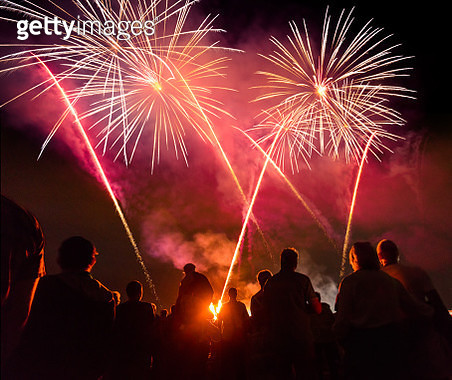 People standing  in front of colorful Firework - gettyimageskorea