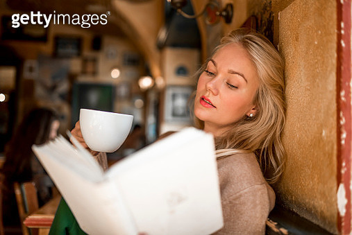 Woman reading a book - gettyimageskorea