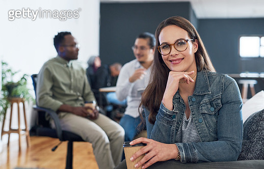 Portrait of a young businesswoman having a meeting with colleagues in a modern office - gettyimageskorea