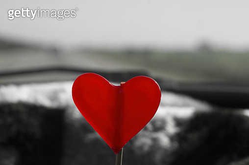 Close-Up Of Heart Shape Candy Against Sky - gettyimageskorea