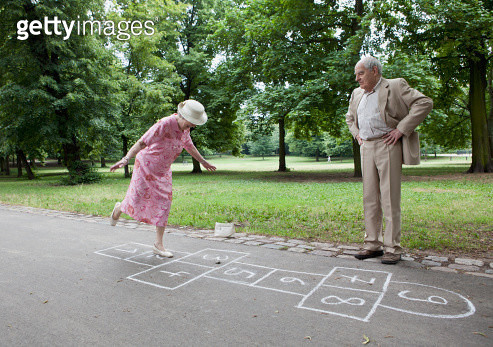 Senior couple play hopscotch - gettyimageskorea