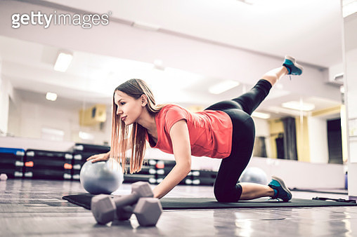 Beautiful Female Athlete Working Out With Fitness Ball - gettyimageskorea