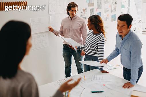 Korean man explaining idea concept in design office planning meeting - gettyimageskorea