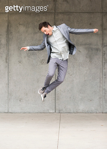 Businessman jumping mid air - gettyimageskorea