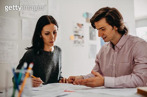 Design professionals discuss ideas in design studio office - gettyimageskorea