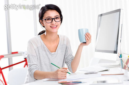 Happy business woman working - gettyimageskorea