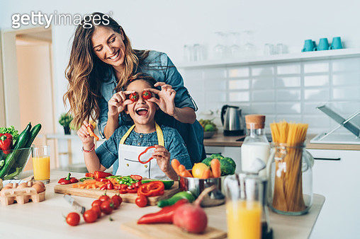 Playful mother and daughter in the kitchen - gettyimageskorea