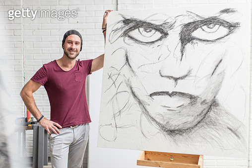 Portrait of confident artist with drawing in studio - gettyimageskorea