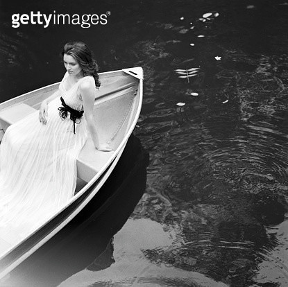Pregnant bride sitting in rowboat - gettyimageskorea
