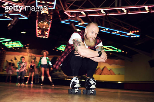 Man having fun at roller disco - gettyimageskorea