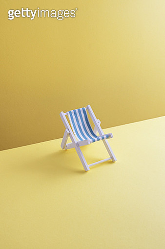 Single beach chair on yellow ground, 3D Rendering - gettyimageskorea