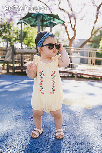 Toddler with sunglasses at playground - gettyimageskorea