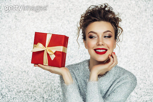 Christmas happy smiling young woman holds gift box in hands - gettyimageskorea