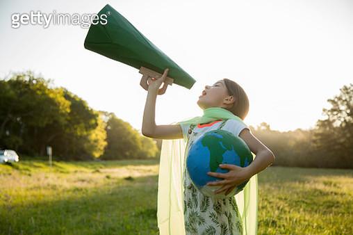Female Eco-warrior shouting into a megaphone - gettyimageskorea