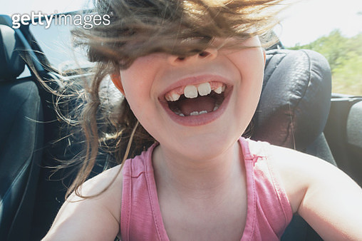 Young girl in convertible car - gettyimageskorea