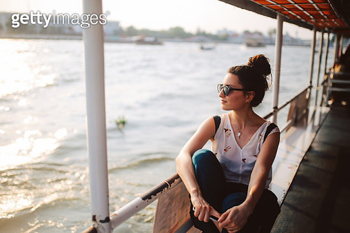 Young tourist woman riding on the Bangkok ferry boat - gettyimageskorea